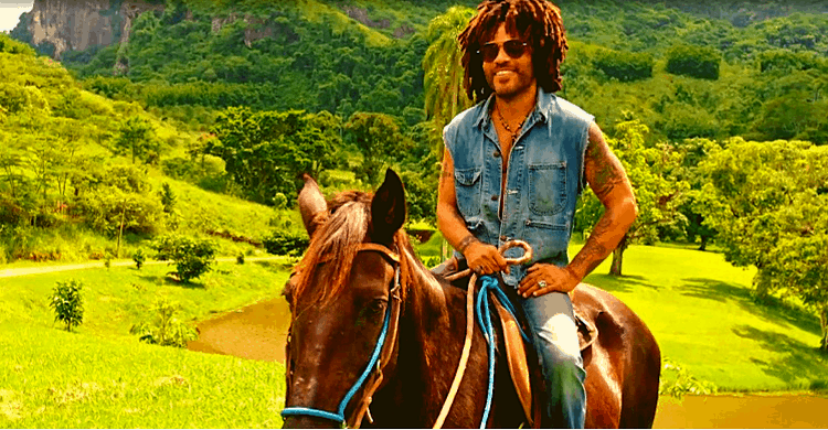Lenny Kravitz riding a horse in his home in Brazil