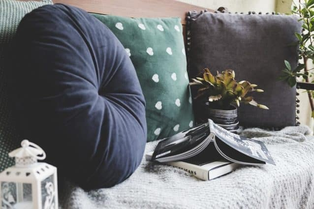 couch with books on it