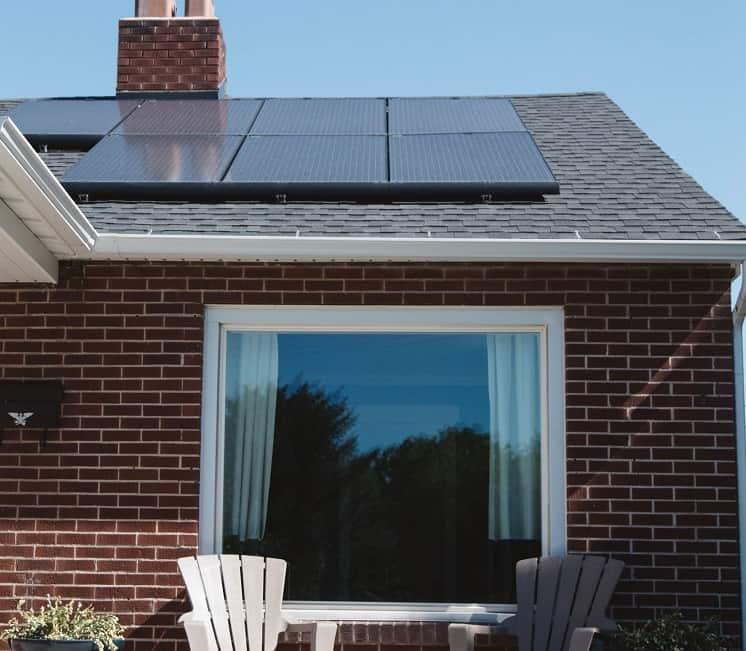 house with solar panels clean energy