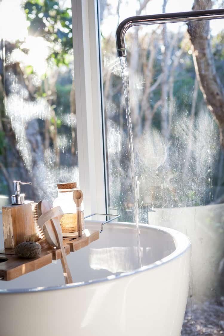 bath tub next to a window