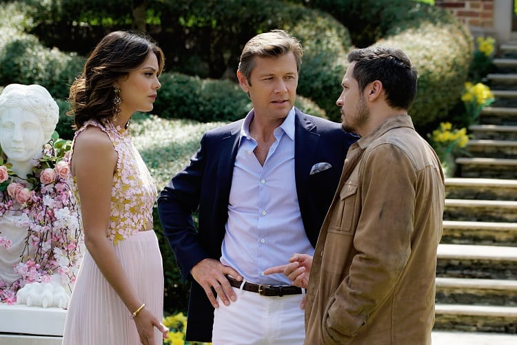 dynasty characters in front of the carrington manor