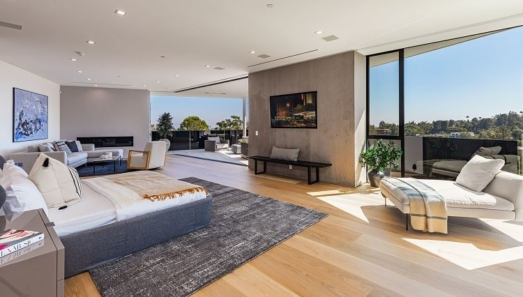The master bedroom in Chrissy Teigen and John Legend's house opens up to stunning views.