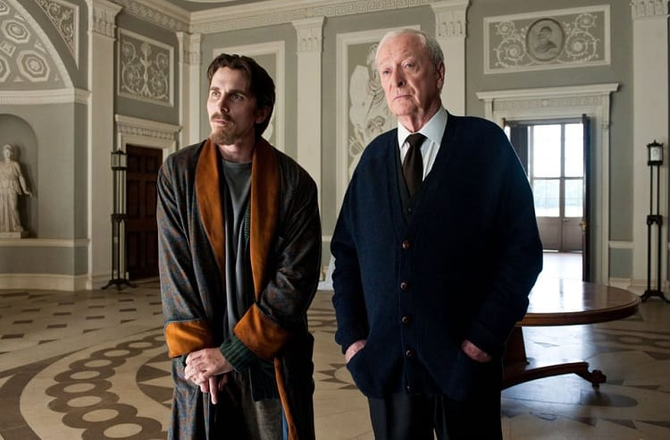 Bruce Wayne and Alfred inside the Wayne Mansion.