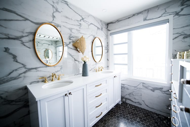 marble bathroom with gold fixtures