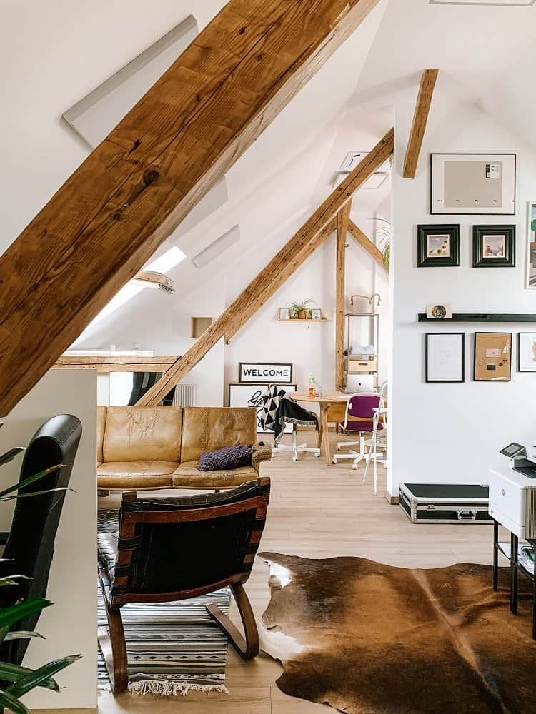 attic living space with exposed beams