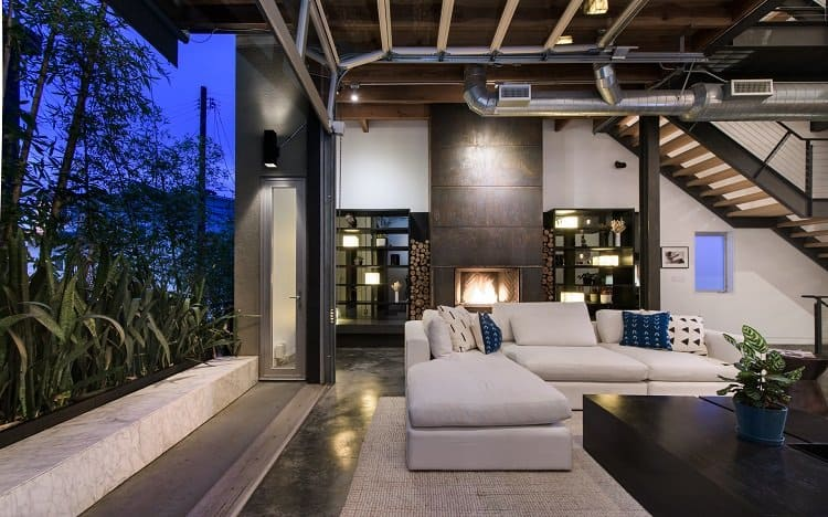 Modern loft in Venice, CA has a unique pull-up garage door window that opens to the outdoors