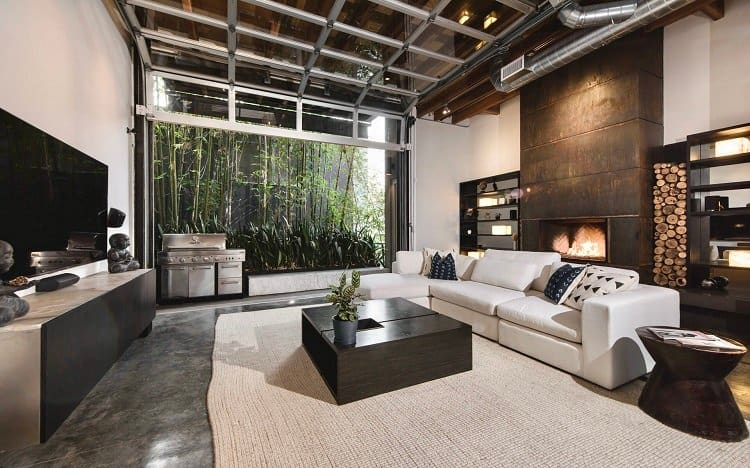 Modern loft in Venice, CA has a unique pull-up garage door window that opens to the outdoors.