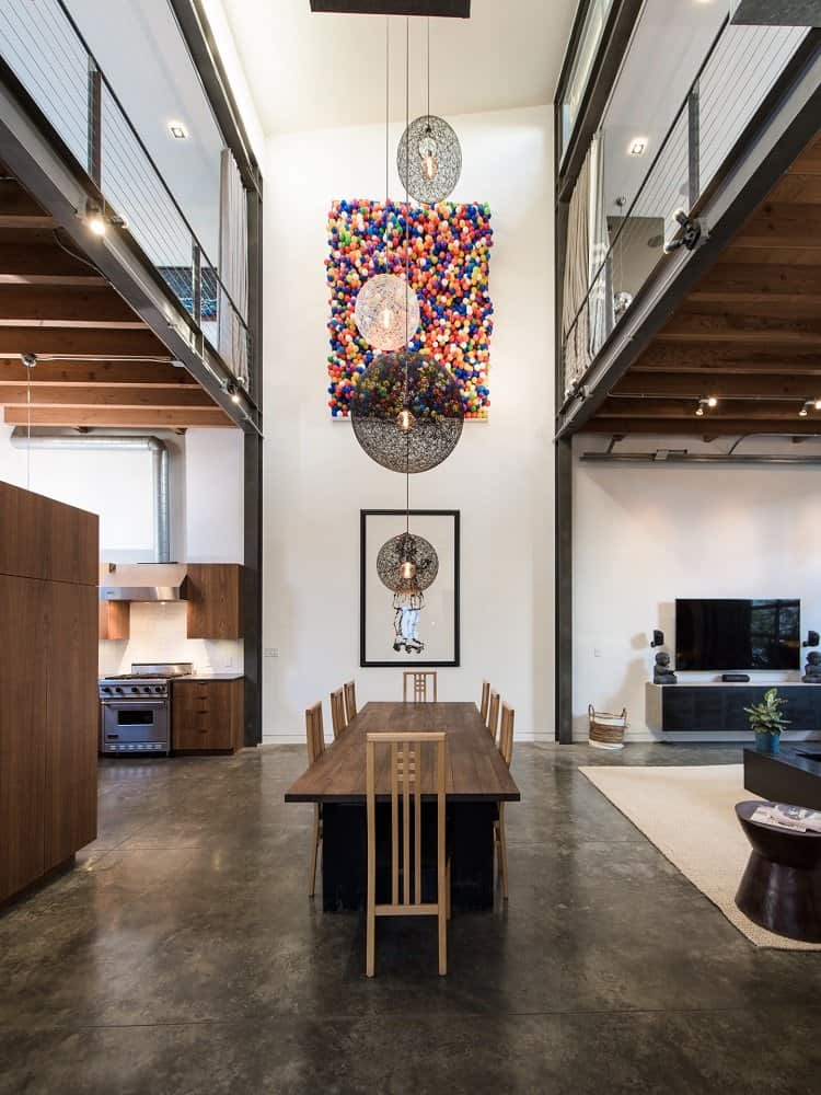 two-story art wall right in the middle of a loft