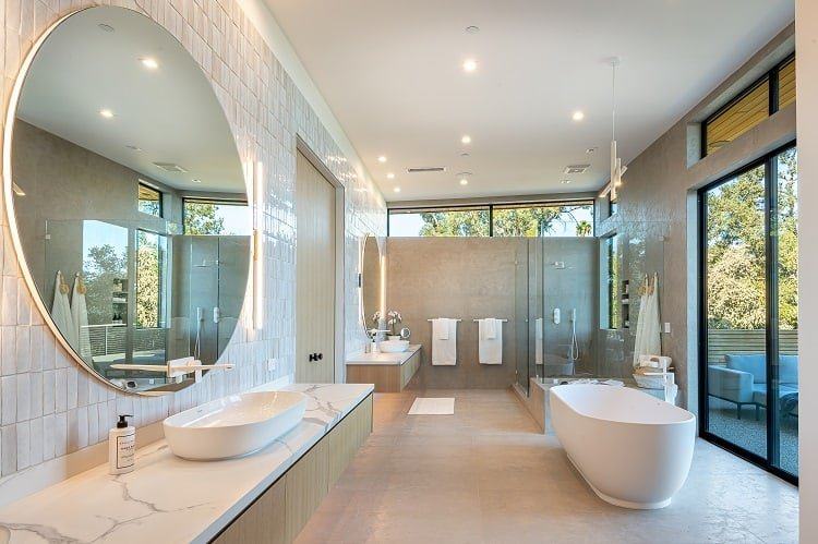 luxurious master bathroom with floor-to-ceiling limestone