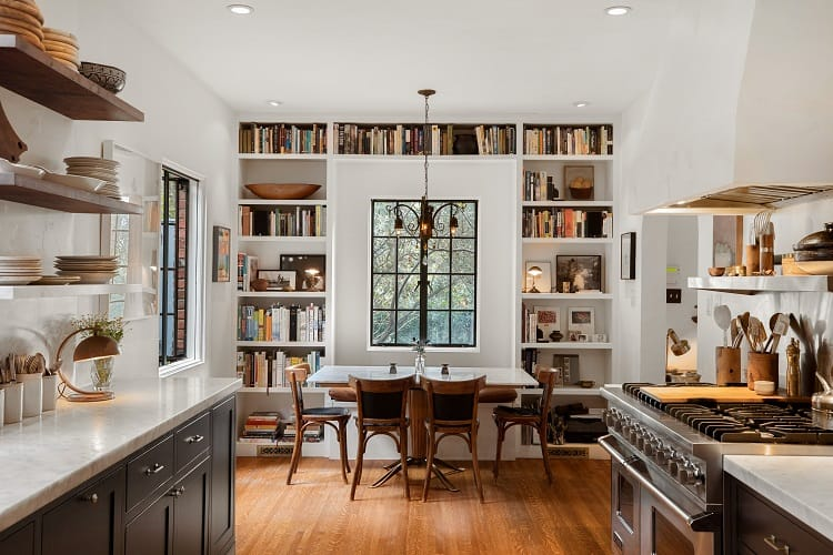 kitchen dining area with incorporated bookshelves