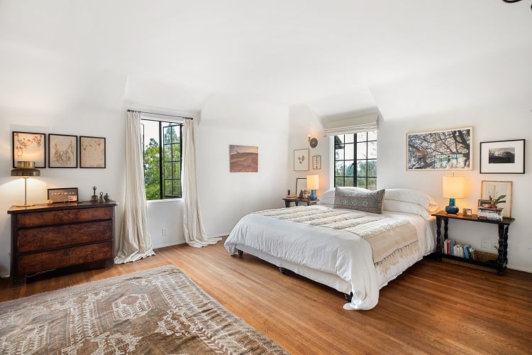 the bright and spacious master bedroom