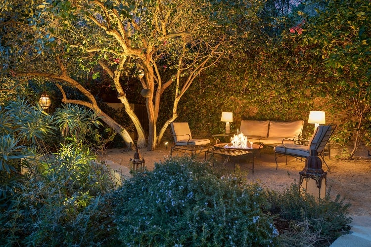 The quiet, private backyard has several seating areas, including one set around a fire pit.