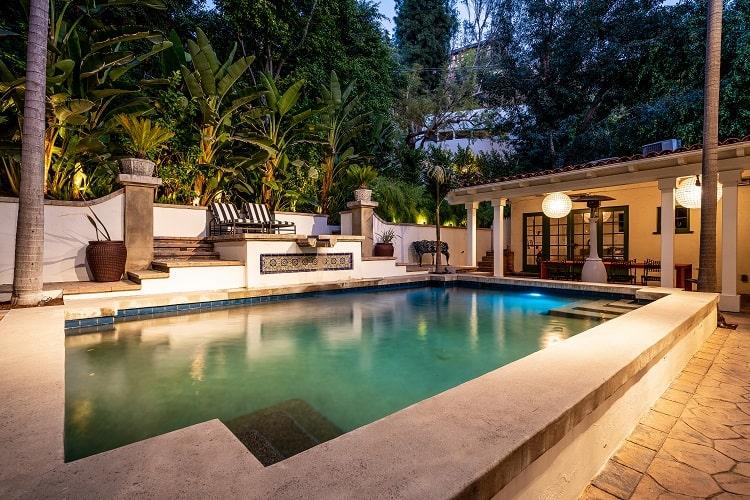 the beautiful pool area of the spanish villa