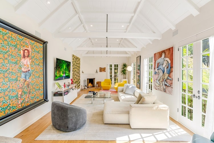 bright, art-filled living room with soaring ceilings