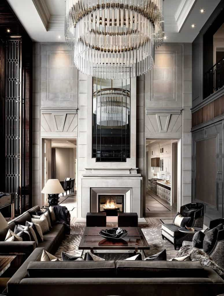 Inside Drake's mansion in Toronto, where a roaring fireplace anchors the luxurious living room.