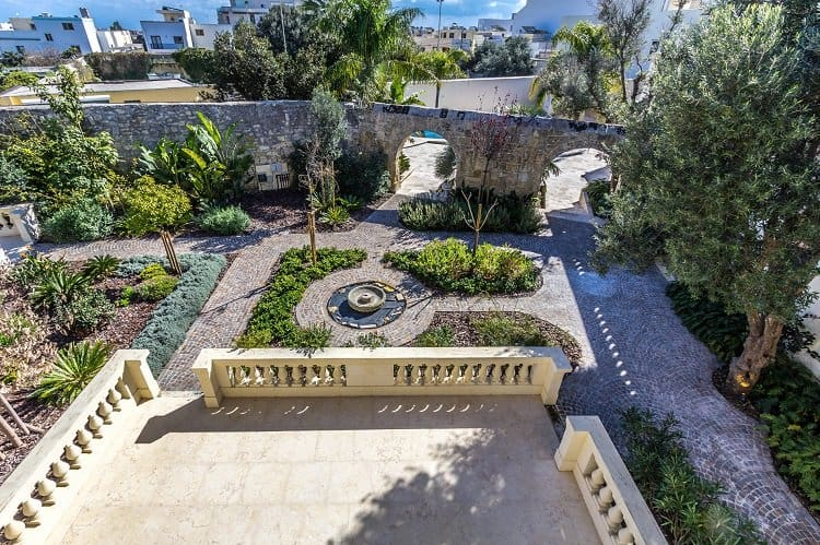 manicured gardens of a maltese palazzo