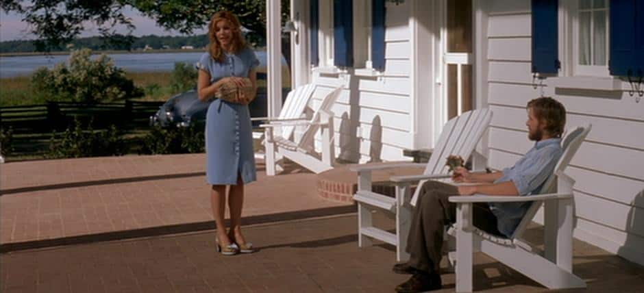 Noah and Allie scene from The Notebook, with the two sitting on the porch of the house.