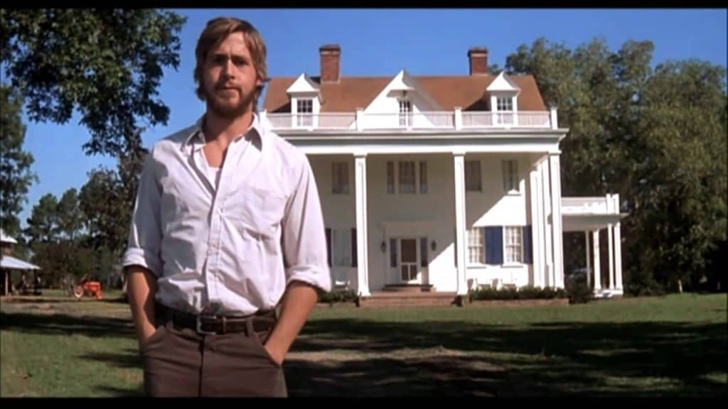 Noah standing in front of the house in The Notebook.
