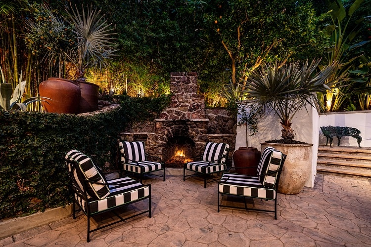 outdoor seating with a fireplace