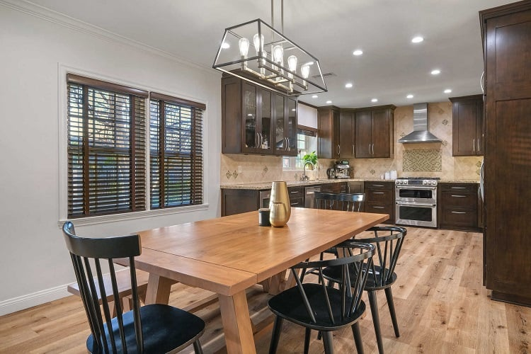 renovated kitchen with dark cabinets