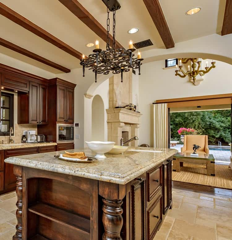 sylvester stallone's kitchen with dark wood and intricate carvings
