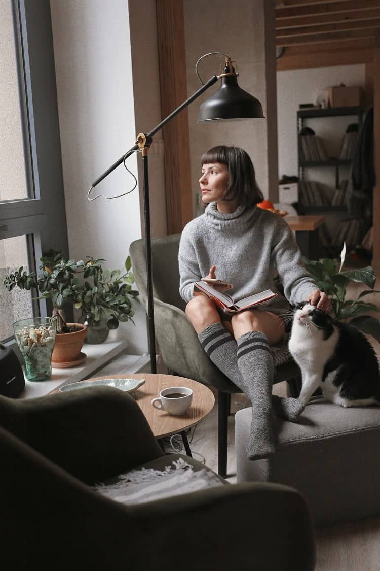 woman at home with her cat