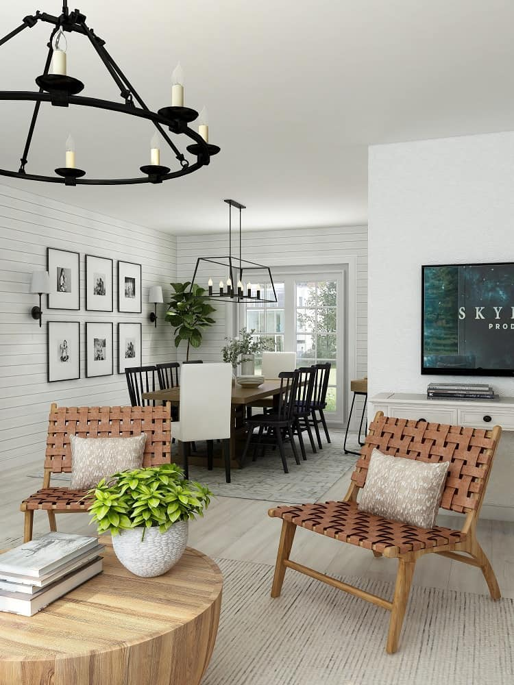 beautifully decorated living space leading into a stylish dining room