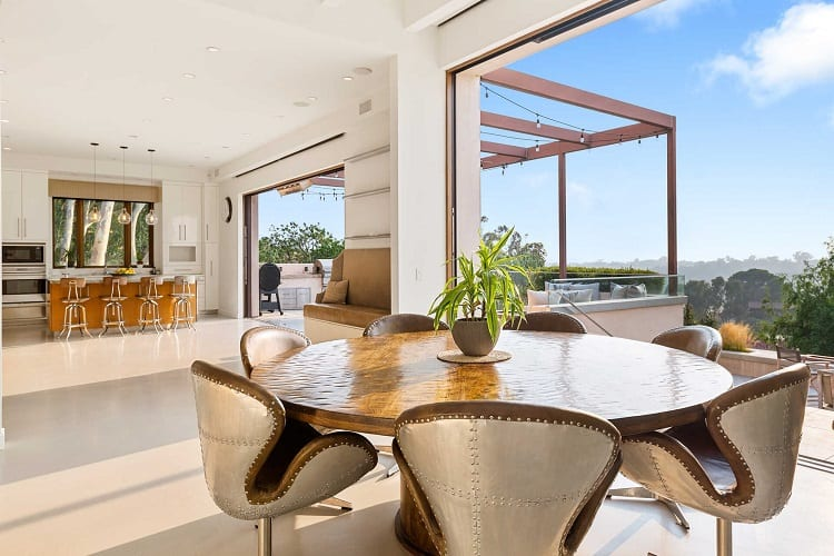 kitchen and dining room with large sliding doors that open up to the outdoor entertaining area