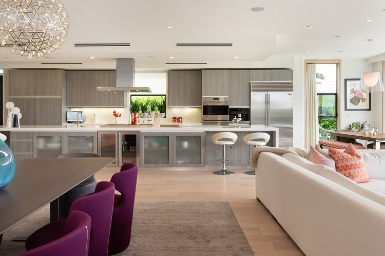 ultra-modern kitchen with a 24-foot stone island