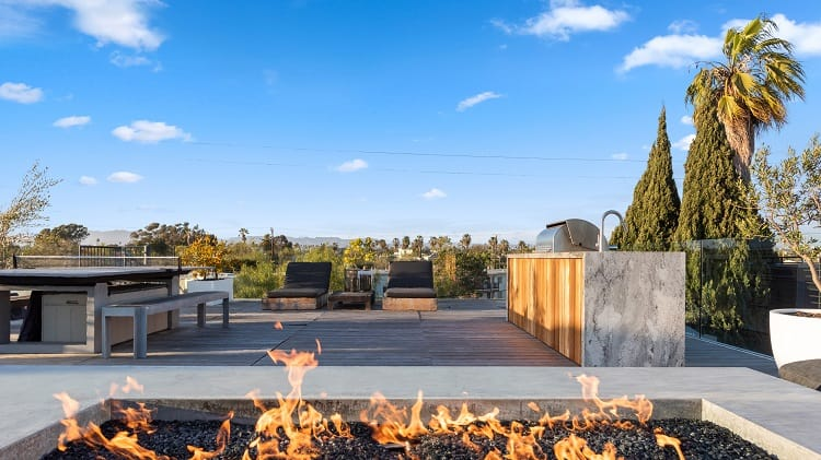 The rooftop deck has expansive fire pit, and plenty of room to lounge and entertain.