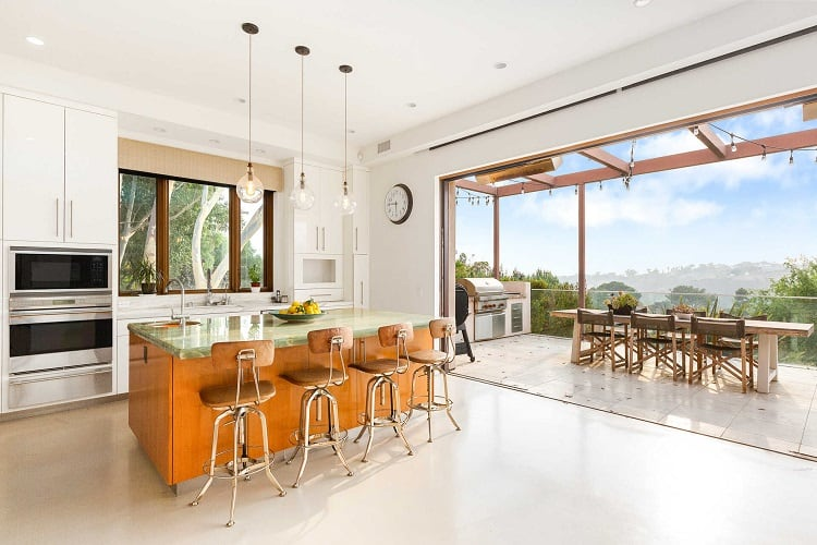 kitchen with large sliding doors that open up to the outdoor entertaining area