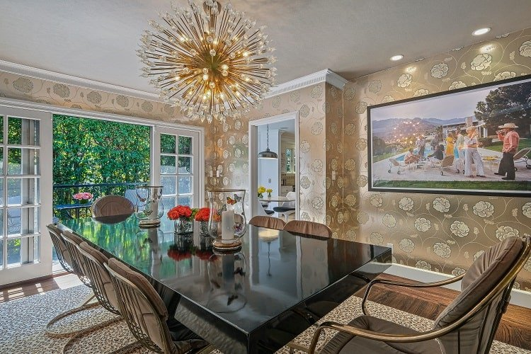 luxury dining room with a bold wallpaper design