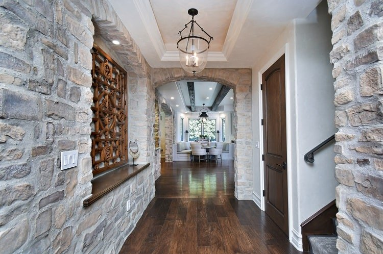 hallways with walls of stone and beautiful wood floors