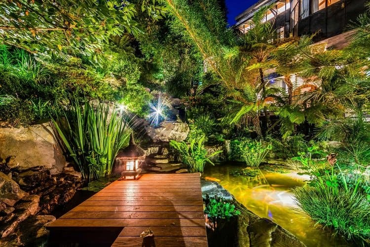 Tommy Lee's house has magical pathways, gardens of bamboo and fern trees, and a Koi pond.