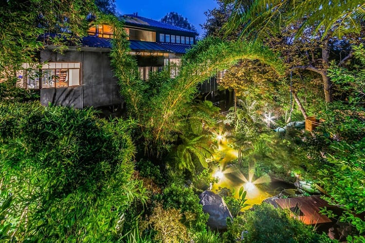 Tommy Lee's new house has unique outdoor features, including magical pathways, gardens of bamboo and fern trees, and a Koi pond.