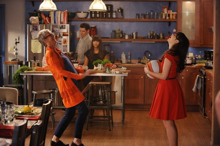 characters from The New Girl laughing in the beautiful kitchen of the loft